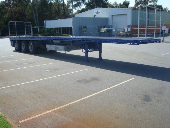 Blue Flat Top Semi-Trailer at the TSE parking lot.
